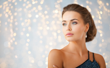 woman in evening dress and diamond earring