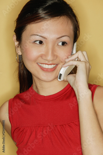 7763ee09de7 Young woman wearing a red top