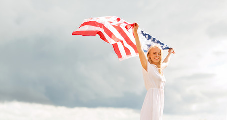happy woman with american flag outdoors