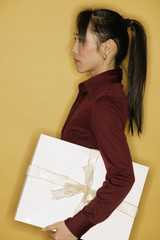 Young woman, side view, yellow background