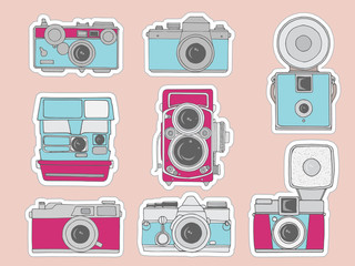 Colorful retro camera set. Hand drawn vintage photocameras set with cute patterns. Vector illustration.