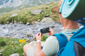 Tourist with camera in mountains