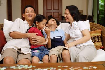 Family in living room, bonding, portrait