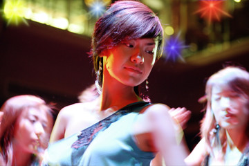 Young woman at night club