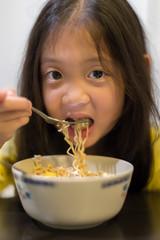 Child Eating Noodle