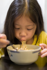 Kid Eating Noodle