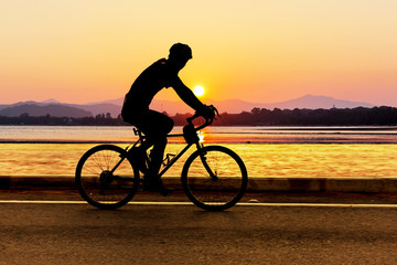 Cycling at beach on twilight