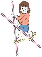 竹馬で遊ぶ女の子