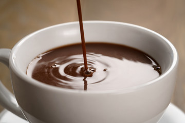 hot chocolate pouring in cup
