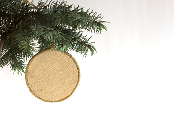 Happy New Year and merry Christmas template copyspace card with hand made craft circle wooden label decorated on Christmas tree branch. White concept price and description winter sale item background.