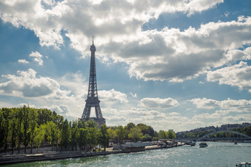 Eiffel Tower. Paris. France. Famous historical landmark on the quay of a river Seine. Romantic, tourist, architecture symbol. Toned