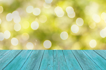 wood floor with abstract green nature background