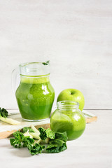 Green smoothie in the jar on the white rustic table. Template for detox recipe