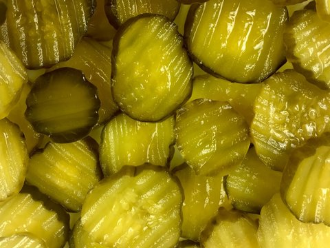 Dill pickle slices filling the frame
