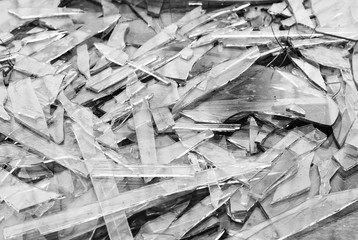 Black and white broken glass fragments texture background