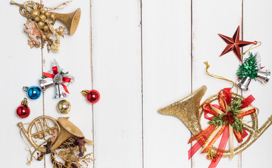 Decoration object ,star,ball color gold ,ribbon  christmas concept white wood background .top view
