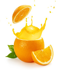Wall Mural - orange juice splashing out of a fruit isolated on white