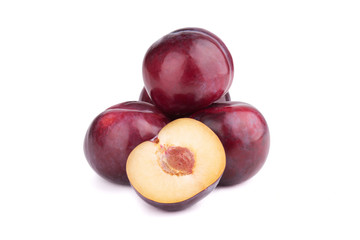 Plum fruits and a half  on white background