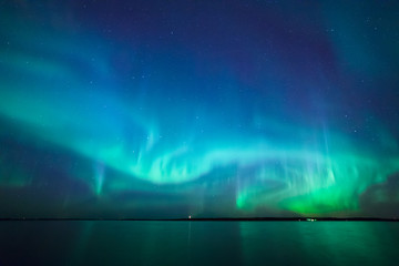 Aluminium Prints Northern lights Northern lights over lake in finland