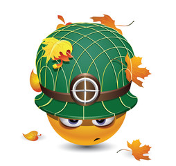 Illustration of a smiley dressed as soldier. Smiley ball as soldier. Smiley with army helmet covered with leafs.