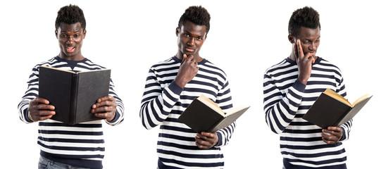 Handsome black man reading book