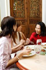 Three women in restaurant, talking