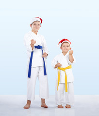 Two karateka stand in the rack karate