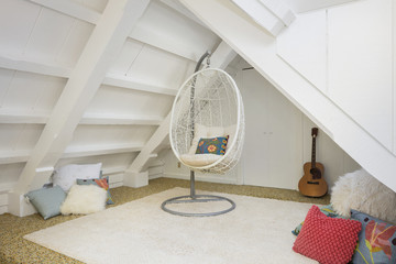 Rattan Hanging Swing Chair within a hang out area under roof.
