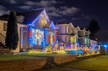 House Decorated and Lighted for Christmas at Night at Vancouver, Canada. Fotomurales