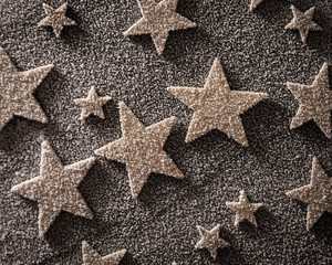 stars on snow. winter abstract background or texture