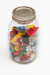 Jar filled with game pieces