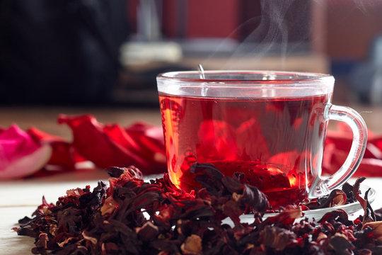 Red Hibiscus tea in glass mug