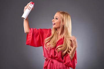 Young woman with a hairspray