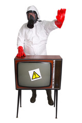 Man in protective suit with retro TV set