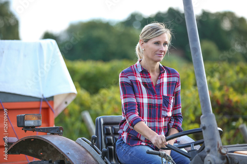 """female farmer with tractor"" Imagens e fotos de stock ..."