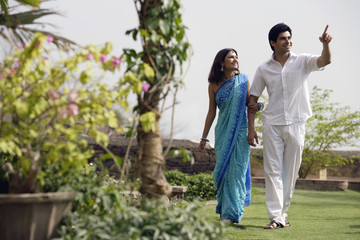 young couple strolling in garden
