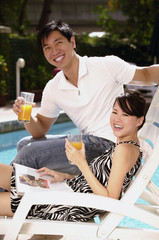 Young couple laughing at the pool