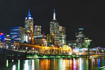 The Melbourne Australia skyline at night with then Yarra River in the foreground