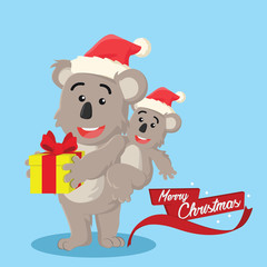 koala holding christmas present with its son
