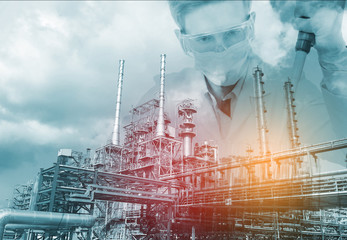 scientist with equipment and science experiments ,Laboratory glassware with petrochemical plant background.