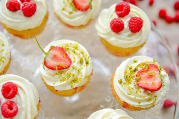 Delicious cupcakes with berries close up