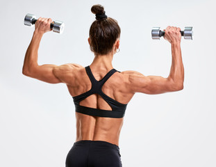 Woman bodybuilder from back