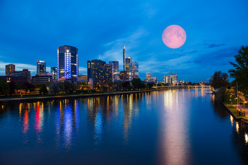 """Skyline of Frankfurt am Main (Germany) at dusk with super moon """"Elements of this image furnished by NASA"""""""