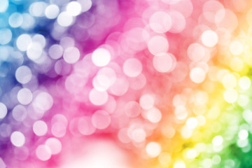 Colorful glitter sparkles defocused rays lights bokeh abstract background.