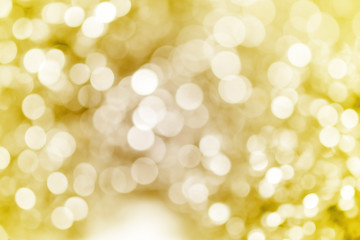 Gold glitter sparkles defocused rays lights bokeh abstract background.