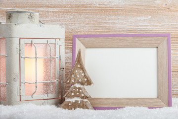 Christmas background with lantern and blank photo frame
