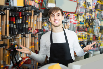 male seller posing at tooling section of household store