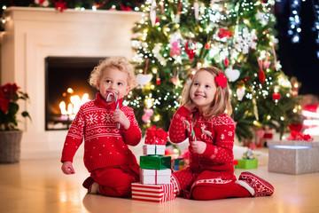 Kids under Christmas tree