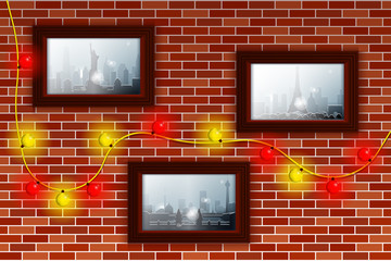Decorated brick wall with Christmas lights and photos. Winter and snowfall in different cities illustrated in the photos. Pictures in brown frames.