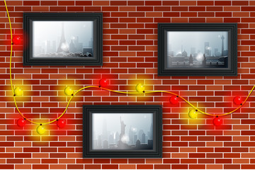 Decorated brick wall with Christmas lights and photos. Winter and snowfall in different cities illustrated in the photos. Pictures in gray frames.
